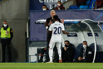 Vinicius Junior of Real Madrid celebrates a goal with Zinedine Zidane, head coach of Real Madrid, during the UEFA Champions League, Quarter finals round 1, football match played between Real Madrid and Liverpool FC at Alfredo Di Stefano stadium on April 06, 2021 in Valdebebas, Madrid, Spain.